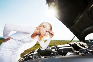 The Mechanics of Acid Reflux: image of woman looking under hood of broken car